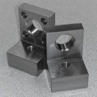 Gib brackets for precision gaging are milled and surface ground, then paired to mill and burnish their ID guide